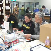 Japanese and non-Japanese work together at the Multi-Language Support Center in Sendai to answer questions from foreign residents after the Great East Japan Earthquake. | SENDAI CITY