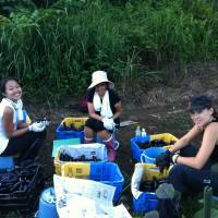 Angela Ortiz (right), OGA For Aid's representative director, and international volunteers work on an agricultural project in Minamisanriku, Miyagi Prefecture. | OGA FOR AID