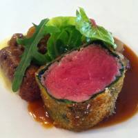 Tender: Lamb wrapped in spinach with merguez sausage, Japanese mushrooms and baby broad beans. | ROBBIE SWINNERTON
