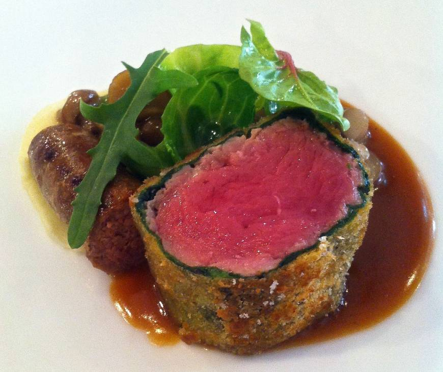 Tender: Lamb wrapped in spinach with merguez sausage, Japanese mushrooms and baby broad beans.   ROBBIE SWINNERTON