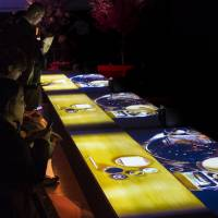 'Diners' are served 3-D projected dishes at the 'L'art de Rosanjin'  | JAMES HADFIELD