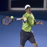 Ferrer tops Nishikori in final