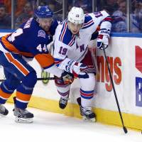 Fast exit: Jesper Fast of the Rangers (right) looks to get away from the Islanders' Calvin de Haan during the Rangers' 2-1 win on Tuesday. | REUTERS/USA TODAY SPORTS