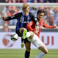 Golden boy: Takashi Usami (left) is hoping to lead treble winners Gamba Osaka to more silverware this season. | KYODO