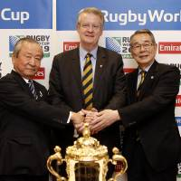 Venues revealed: (from left) Akira Shimazu, CEO of the Rugby World Cup 2019 Organizing Committee, Rugby World Cup chairman Bernard Lapasset and Japan Rugby Union chairman Tatsuzo Yabe attend a news conference on Monday in Dublin, where Japan's 12 host cities were announced. | KYODO/AP
