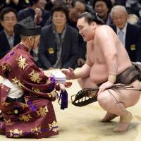 One more for the record books: Hakuho is sumo's all-time leader in titles. | KYODO