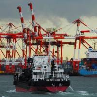 A vessel passes Oi Container Terminal.   KIT NAGAMURA