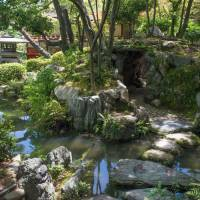 Picture perfect: This man-made section of Kobe's Soraku-en contains a stream that suggests a river dropping from mountain slopes to the sea.   STEPHEN MANSFIELD