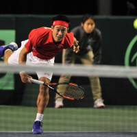 In the line of duty: Kei Nishikori returns the ball to Vasek Pospisil during their Davis Cup match on Friday. Nishikori won 6-4, 7-5 (7-5), 6-3. | AFP-JIJI