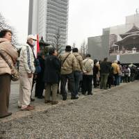 Mostly elderly attendees line up outside the Tokyo Metropolitan Memorial Hall in Yokoamicho Park on Tuesday for a service to mark the 70th anniversary of the Great Tokyo Air Raid. | IAN MUNROE