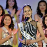 Symbol of progress?: Ariana Miyamoto, the child of a black American father and Japanese mother and representing Nagasaki Prefecture, gives her acceptance speech after being crowned Miss Universe Japan in Tokyo on March 12. | KYODO