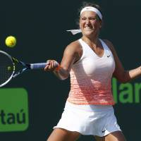 Smooth start: Victoria Azarenka plays a shot from Spain's Silvia Soler-Espinosa in their first-round match at the Miami Open on Wednesday. Azarenka won 6-1, 6-3. | REUTERS/USA TODAY SPORTS