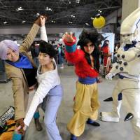 All dressed up with somewhere to go: Once banned from such events, amateur cosplayers are now welcome at AnimeJapan. | YOSHIAKI MIURA