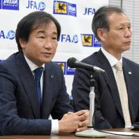 Starting again: Masahiro Shimoda (left), the Japan Football Association's technical director, addresses the media during a Thursday evening news conference in Tokyo, where Bosnian Vahid Halilhodzic was named Japan's new national team manager. JFA secretar-general Hiromi Hara is seated next to Shimoda. | AFP-JIJI