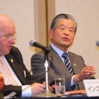 Working toward a solution: Japan 2024 Task Force co-chairmen Ingo Weiss and Saburo Kawabuchi address the media at a news conference in Tokyo on Wednesday. | KAZ NAGATSUKA