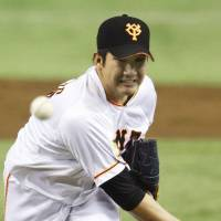 Solid effort: Giants starter Tomoyuki Sugano held the BayStars to one run over seven innings in the season-opening game for both teams on Friday. Yomiuri defeated Yokohama 3-2 at Tokyo Dome. | KYODO