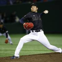 Rough outing: Japan starter Takahiro Matsuba yielded five runs and took the loss in Wednesday's game against Team Europe. | AP