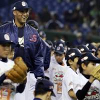 Learn from the master: Derek Jeter smiles during a baseball clinic at a charity event at Tokyo Dome on Saturday. | AP