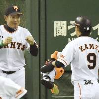 Winning start: Giants manager Tatsunori Hara is pumped up after Yoshiyuki Kamei's two-run home run in the second inning of Friday's game against the BayStars at Tokyo Dome. Yomiuri topped Yokohama 3-2. | KYODO