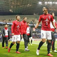 House of horrors: Urawa Reds players leave the pitch after losing to Brisbane Roar in the Asian Champions League on Wednesday in Saitama.   KYODO