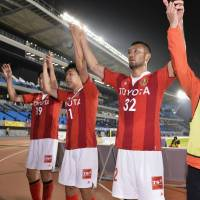 Notice me: Nagoya's Kengo Kawamata (right) celebrates with teammates after Grampus' win over Frontale on Wednesday. | KYODO