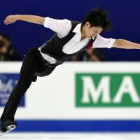 Not his best: Takahiko Kozuka performs during the men's short program at the World Figure Skating Championships on Friday in Shangahai. Kozuka is in 19th place. | AFP-JIJI