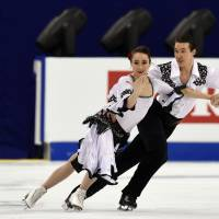 One and done: Cathy and Chris Reed perform their ice dance short program at the World Figure Skating Championships on Wednesday in Shanghai. The Reeds failed to advance to the free dance. | AFP-JIJI