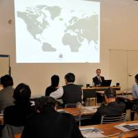 Halldor Elis Olafsson speaks about Icelandic geothermal energy usage at a seminar in Tokyo on March 27. | YOSHIAKI MIURA