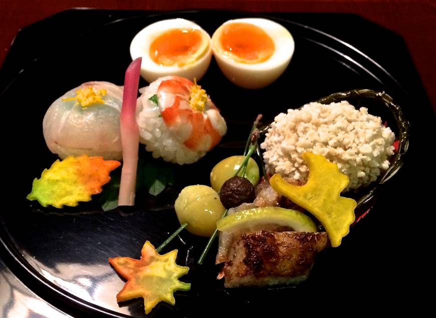 The hassun (mixed seasonal specialties) plate features Hyotei's signature hanjuku (soft-boiled) egg. | ROBBIE SWINNERTON