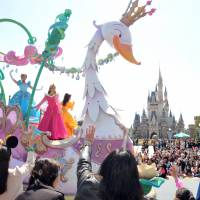 The show goes on: Visitors watch a parade at Tokyo Disneyland in April 2013 in Urayasu, Chiba Prefecture. | YOSHIAKI MIURA