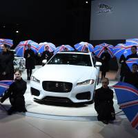 Dancing girls perform at the Jaguar media conference Wednesday during the New York Auto Show at the Jacob Javits Center in New York.   AFP-JIJI
