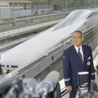 Yasukazu Endo, who heads the Central Japan Railway Co. maglev trials facility in Yamanashi Prefecture, addresses reporters Tuesday after the train broke the world speed record, achieving 603 kph. | KYODO
