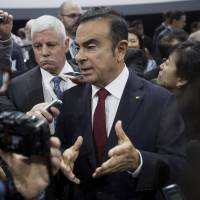 Nissan Motor Co. CEO Carlos Ghosn speaks to the media during the 2015 New York International Auto Show on Thursday. Ghosn said Nissan plans to launch self-driving cars in Japan in 2016. | BLOOMBERG