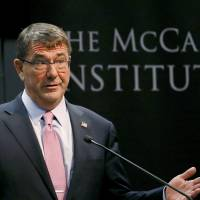 U.S. Secretary of Defense Ash Carter waits to speak, Monday at the the McCain Institute at Arizona State University in Tempe. The Obama administration is opening a new phase of its strategic 'rebalance' toward Asia and the Pacific by investing in high-end weapons such as a new long-range stealth bomber, refreshing its defense alliance with Japan and expanding trade partnerships, Carter said Monday. | AP