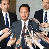 Economic Revitalization Minister Akira Amari answers reporters' questions after arriving at his office ahead of talks with visiting U.S. Trade Representative Michael Froman (not pictured) over deadlocked Trans-Pacific Partnership negotiations in Tokyo on Monday. | AFP-JIJI