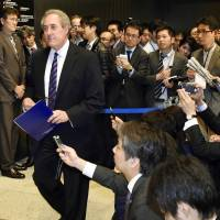U.S. Trade Representative Michael Froman leaves after briefing reporters in Tokyo in the early hours Tuesday on his marathon TPP talks with counterpart Akira Amari.   KYODO