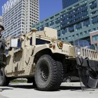 Troops patrol Baltimore in wake of paralyzing riots, fires; Obama denounces unrest