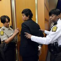 Former Deerwood Academy Assistant Principal Tabeeka Jordan is led to a holding cell after a jury found her guilty in the Atlanta Public Schools test-cheating trial Wednesday in Atlanta. Jordan and 10 other former Atlanta Public Schools educators accused of participating in a test cheating conspiracy that drew nationwide attention were convicted Wednesday of racketeering charges. | AP