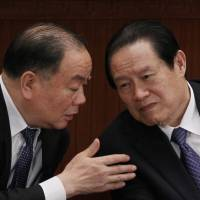 China charges former security chief with bribery, abuse of power