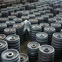 A worker inspects stacks of train wheels at a Ma Steel wheel and tire plant in Maanshan, Anhui Province, China. More than three decades after Beijing began allowing market reforms, China's 168 million migrant workers are discovering their labor rights through the spread of social media and protests. | QILAI SHEN