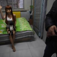A man who gave only his surname, Liu, stands next to his high-end sex doll at his apartment in an industrial suburb of Beijing on Feb. 14. China's puritanical Communist Party decried decadence during its first decades in power, and while conservative attitudes are still widespread, economic reforms have brought the country more sexual freedom — and a plethora of sex shops. | AFP-JIJI