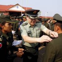 In bid to 'split ASEAN,' China pours money, arms into Cambodian military