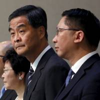 Hong Kong Chief Executive Leung Chun-ying (second from right) stands beside Secretary for Constitutional and Mainland Affairs Raymond Tam (left), Chief Secretary Carrie Lam (second from left) and Secretary for Justice Rimsky Yuen, ahead of a Legislative Council meeting in the city on Wednesday. | REUTERS