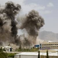 Smoke billows from a Saudi-led airstrike on Sanaa Wednesday. A state-run broadcaster in Iran is reporting that the Islamic Republic has sent a navy destroyer and another vessel to waters near Yemen amid a Saudi-led airstrike campaign.   AP