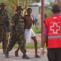 Troops end Kenya university attack after Somali Islamists kill at least 147 students