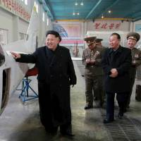 North Korean leader Kim Jong Un visits a machine plant in this undated photo released Wednesday.   REUTERS