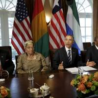 U.S. President Barack Obama gestures in a meeting Wednesay at the White House with West African counterparts (from left) Ernest Bai Koroma of Sierra Leone, Ellen Johnson Sirleaf of Liberia and Alpha Conde of Guinea to discuss international progress made on the Ebola crisis. | REUTERS