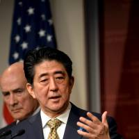 Prime Minister Shinzo Abe answers questions from the crowd at Harvard University's John F. Kennedy School of Government in Cambridge, Massachusetts on Monday. | REUTERS