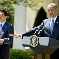President Barack Obama and Prime Minister Shinzo Abe participate in a joint news conference Tuesday, in the Rose Garden of the White House. | AP