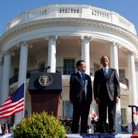 President Barack Obama stands withPrime Minister Shinzo Abe on the South Lawn of the White House Tuesday during a state arrival ceremony. | AP